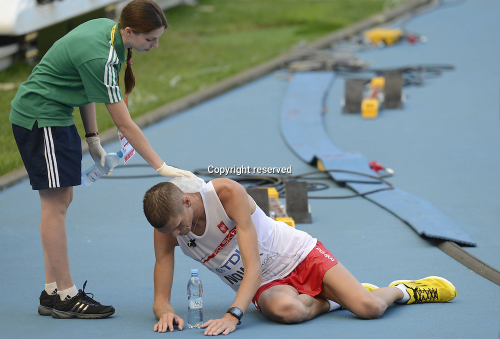14.08.2013. Moscow, Russia. IAAF World Championship Athletics.  Big Sports Arena Luzhniki MoscowLukasz Nowak r of Poland collapses After the mens 50 Kilometers Race Walk Final of The 14th IAAF World Athletics Championships MOSCOW