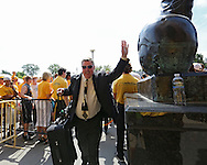 August 31 2013: Iowa Hawkeyes offensive coordinator Greg Davis walks in past the statue of Nile Kinnick before the start of the NCAA football game between the Northern Illinois Huskies and the Iowa Hawkeyes at Kinnick Stadium in Iowa City, Iowa on August 31, 2013. Northern Illinois defeated Iowa 30-27.