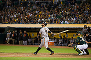 San Francisco Giants first baseman Brandon Belt (9) bats against the Oakland Athletics at Oakland Coliseum in Oakland, California, on July 31, 2017. (Stan Olszewski/Special to S.F. Examiner)