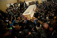 RAWALPINDI, PAKISTAN - DECEMBER 27: The body of former Prime Minister Benazir Bhutto is carried out of Rawalpindi General Hospital on December 27, 2007. The opposition leader has died from a bullet wound to the neck after speaking at a rally in the northern city where an estimated 15 people were left dead by the explosion, a party official and Bhutto's husband have been quoted as saying. (Photo by Warrick Page)
