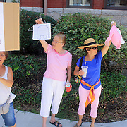 Carla Tevelow, left, Judi Rabak, center, and Lynn Harris protest at the coursthouse on 3rd street in Wilmington, N.C. on Monday August 12, 2013. Vlasits was part of a group that later marched to the law office of Thom Goolsby in protest of Goolsby's support of abortion restrictions being inserted into a bill abou motorcycle safety. (Jason A. Frizzelle)