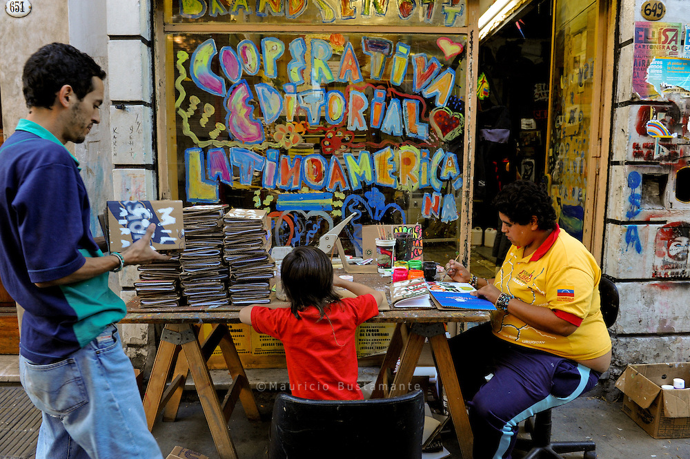 "Eloísa Cartonera, are a work cooperative placed in the neighborhood of La Boca in the city of Buenos Aires, Argentina. They produce handmade books with cardboard covers. They purchase this cardboard from the urban pickers (""cartoneros"") who pick it from the streets. ..It all began with the crisis of 2001 - as some say ""we are a product of the crisis,"" or that we ""aestheticized misery"". Actually, it was nothing like that. This is a a group of people who came together to work in a different way, to learn new things through work, to build up a cooperative, to learn how to subsist and manage ourselves, to work towards a common good. Like many of the movements and collectives born from these insane times, This people  are organized into a cooperative or a small assembly group, as there were also neighborhood and community groups, all sorts of social movements."