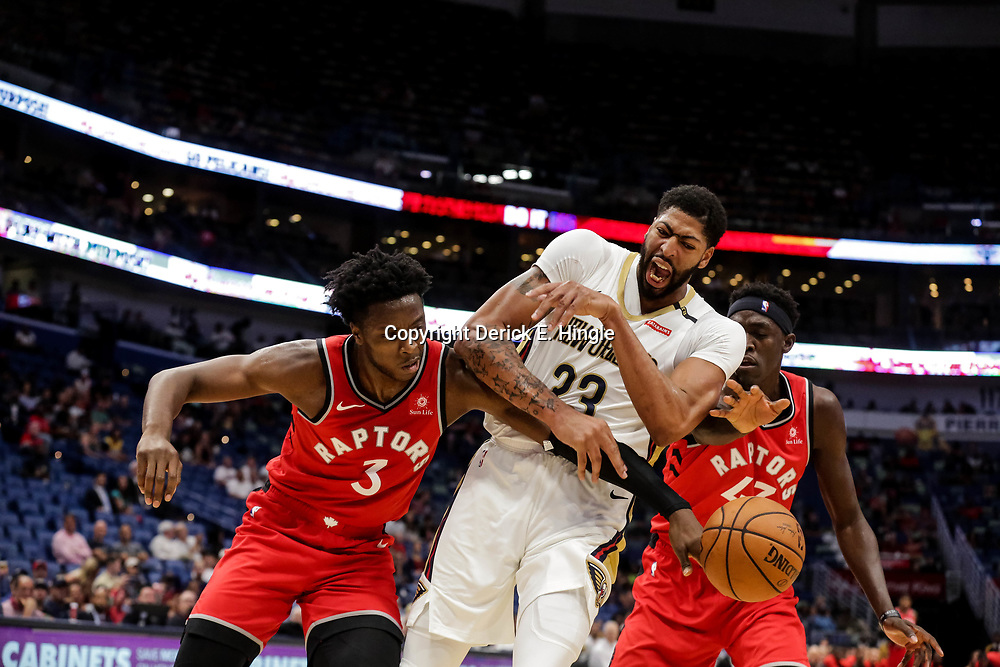 Oct 11, 2018; New Orleans, LA, USA; New Orleans Pelicans forward Anthony Davis (23) has the ball knocked away by Toronto Raptors forward OG Anunoby (3) as forward Pascal Siakam (43) defends during the first half at the Smoothie King Center. Mandatory Credit: Derick E. Hingle-USA TODAY Sports