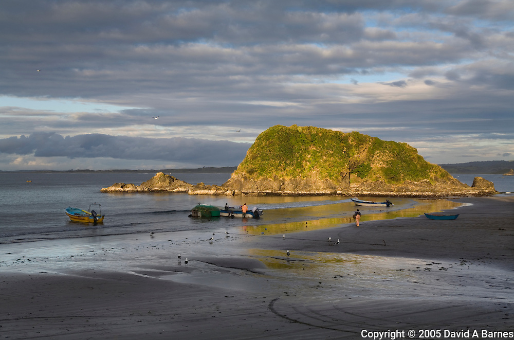 Fishermen with their boats on beach at Pumilahue, Chiloe, Patagonia, Chile