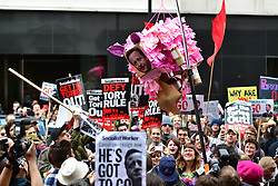 © Licensed to London News Pictures. 08/04/2016. London, UK. Uncut protestors smash up a pink pig pinata with David Cameron's face on it add they storm the Conservative Party Spring Forum in central London.  Conservative party leader and British prime minster David Cameron has come under pressure after it was revealed that he had  investment in an offshore fund.  Photo credit: Ben Cawthra/LNP