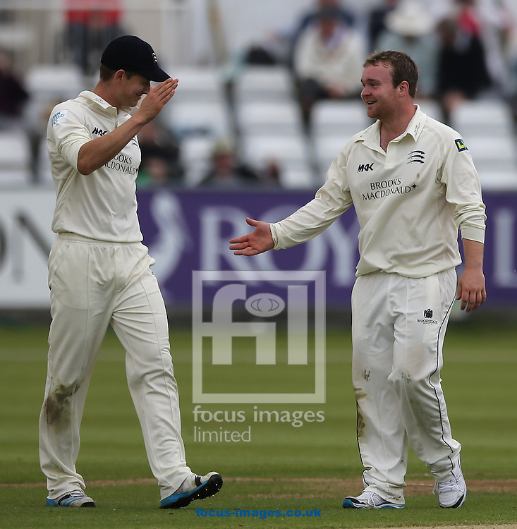 Paul Stirling (r) of Middlesex County Cricket Club is congratulated after taking the wicket of Durhams Mark Stoneman during the LV County Championship Div One match at Emirates Durham ICG, Chester-le-Street<br /> Picture by Simon Moore/Focus Images Ltd 07807 671782<br /> 01/06/2014
