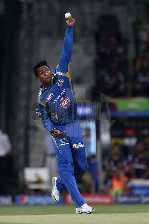 Pragyan Ohja of the Mumbai Indians during match 1 of the Pepsi Indian Premier League Season 7 between the Mumbai Indians and The Kolkata Knight Riders held at the Sheikh Zayed Stadium, Abu Dhabi, United Arab Emirates on the 16th April 2014<br /> <br /> Photo by Ron Gaunt / IPL / SPORTZPICS