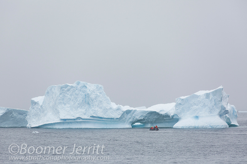 A Zodiak cruise explores icebergs near Cuverville Island lying in the Errera Channel.  The Antarctic Peninsula.  Antarctica