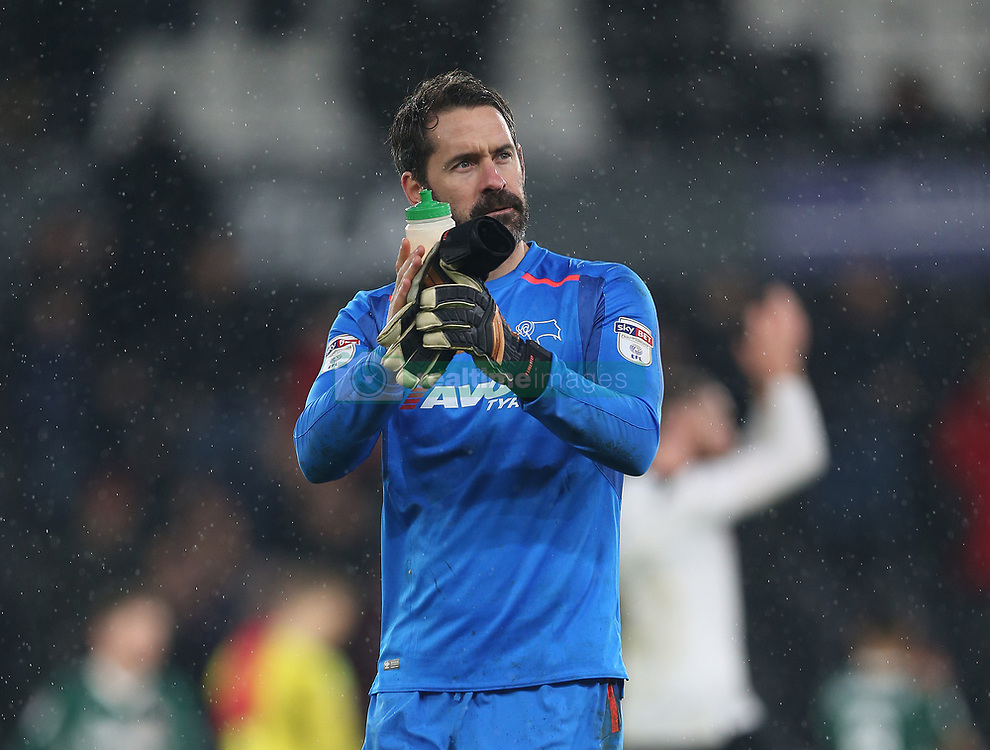 Derby County's keeper Scott Carson applauds the fans at the end of the game against Brentford's during the Sky Bet Championship match at Pride Park