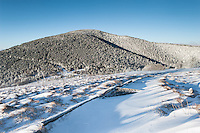 The Appalachian Trail up to Round Bald in the Roan Highlands is covered in light snow after a quick winter storm.  The Roan Highlands are part of the Southern Appalachian Mountains along the state borders of Western North Carolina and Eastern Tennessee.