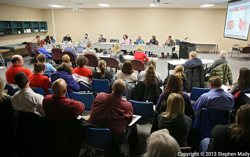 People listen during a Linn-Mar Community School District Board of Education meeting at the Linn-Mar Learning Resource Center in Marion on December 9, 2013.