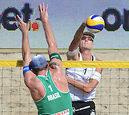 STARE JABLONKI POLAND - July 4: Martins Plavins of Latvia and Alison  Cerutti /1/of Brazil in action during Day 4 of the FIVB Beach Volleyball World Championships on July 4, 2013 in Stare Jablonki Poland.  (Photo by Piotr Hawalej)