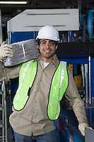 Man carrying newspapers in factory