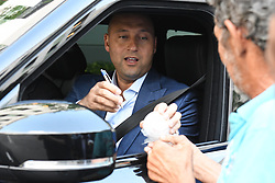 EXCLUSIVE: Yankees' iconic former captain Derek Jeter attends a press conference to announce that he is now officially the CEO of the Miami Marlins. Jeter was wearing a blue suit as he stopped his car to sign autographs after the event, and seated beside him was Marlins' principle owner Bruce Sherman. His wife, Hannah Jeter, who also attended the news conference, was seen arriving back to their hotel in a black dress. The Sports Illustrated cover model gave birth to the couple's first daughter, Bella Raine, less than two months ago. Later, The trio was seen heading out to a celebratory dinner at Komodo Restaurant, where they dined in a private space away from onlookers. Hannah changed into a silky white blouse and skin tight jeans while Derek opted to stay in the blue suit he wore earlier in the day. Derek held the door for hannah as they entered the eatery, and the happy couple held hands as they left later. 03 Oct 2017 Pictured: Derek Jeter. Photo credit: MEGA TheMegaAgency.com +1 888 505 6342
