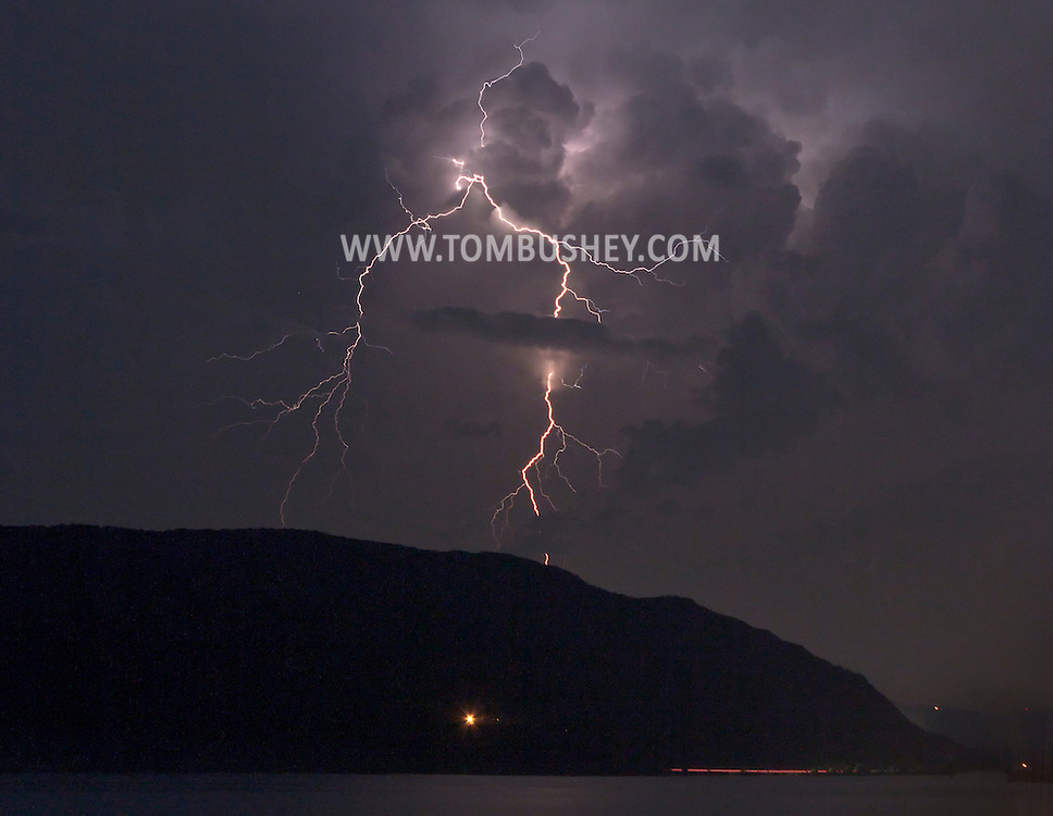 Newburgh, New York - Lightning illuminates the sky above the Hudson River in a view looking south from Bay View Terrace on July 4, 2012.