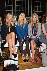 Left to right, LAURA WHITMORE, LADY MARY CHARTERIS and DONNA AIR at the Gyunel Spring Summer 2015 fashion show as part of London Fashion week 2015 held at Victoria House, Bloomsbury Square, London on 12th September 2014.