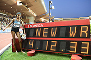 Sifan Hassan (NED) poses with scoreboard after winning the Brave Like Gabe women's  mile in a world record 4:12.33 during the Herculis Monaco in an IAAF Diamond League meet at Stade Louis II stadium in Fontvieille, Monaco on Friday, July 12, 2019. (Jiro Mochizukii/Image of Sport)