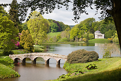 © Licensed to London News Pictures. 20/05/2015. Stourhead, UK. A view of the warm, sunny weather at the National Trust Property, Stourhead, in Wiltshire today, 20th May 2015.  The Pantheon is seen across the lake. Photo credit : Rob Arnold/LNP