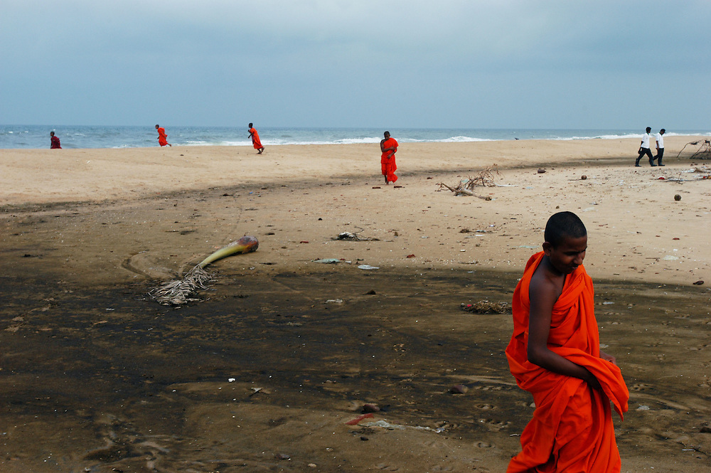 Buddhist monks stroll along the beaches of S.E. Sri Lanka, one of the areas hardest hit by the Tsunami caused by a 9.0 earthquake in the Indian Ocean on December 26th, 2004..Kalmunai, Ampara District, Sri Lanka. 12/01/2005.Photo © J.B. Russell