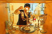 Religious Jewish woman lights Shabbat candles in her home