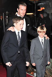 © Licensed to London News Pictures. 19/12/2011. London, England. David Beckham with sons Romeo Beckham; Brooklyn Beckham attend a Night Of Heros , the Sun Military Awards 2011 held on Monday 19th Dec at the Imperial War Museum London . the awards will be televised on Wed 21st December 2011 .  Photo credit : ALAN ROXBOROUGH/LNP