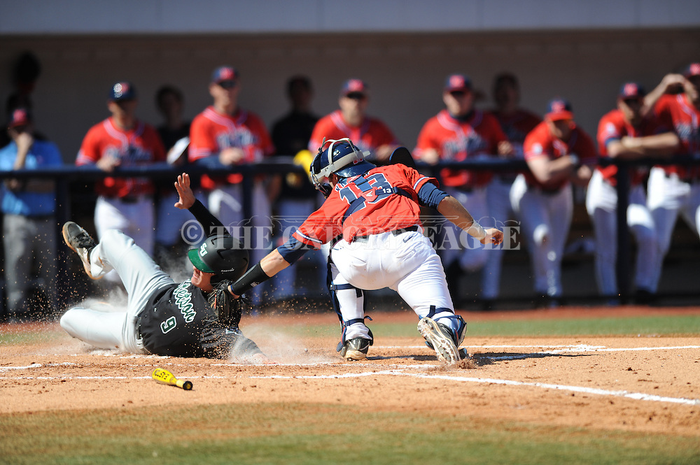 Ole Miss catcher Austin Knight (13) tags out Stetson's Will Mackenzie (9) at Oxford-University Stadium in Oxford, Miss. on Saturday, March 7, 2015. Ole Miss won 8-3 to improve to 7-5.