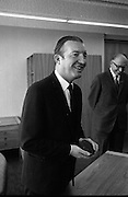 Presentation of New Decimal Coins to Charlie Haughey TD, Minister for Finance, by Dr. T. K. Whitaker, Governor of the Central Bank, at Fitzwilton House..03.09.1969, T.K. Whitaker,