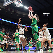 March 31, 2019; Portland, OR, USA; Oregon Ducks guard Sabrina Ionescu (20) shoots over Mississippi State Bulldogs in the Elite Eight of the NCAA Women's Tournament at Moda Center.<br /> Photo by Jaime Valdez
