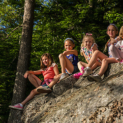 Five girls on a rock near Page Pond in Meredith, New Hampshire.