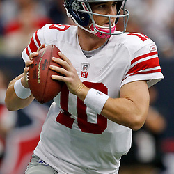 October 10, 2010; Houston, TX USA; New York Giants quarterback Eli Manning (10) looks to throw against the Houston Texans during the first half at Reliant Stadium. Mandatory Credit: Derick E. Hingle