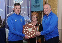 Mary Higgins presenting the Cathal Higgins memorial trophy to Westport GAA Minor player of the year Kevin Lavelle alongside Damien Loftus. <br />