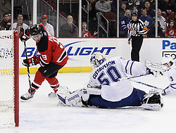 Jan 29, 2010; Newark, NJ, USA; Toronto Maple Leafs goalie Jonas Gustavsson (50) makes a save on New Jersey Devils left wing Zach Parise (9) during the second period at the Prudential Center.