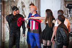 © Licensed to London News Pictures . 30/10/2016 . Manchester , UK . A man dressed as Captain America separates a man dressed as Batman from a man and a woman , during an argument . Revellers on a night out , many in fancy dress , on the weekend before Halloween . Photo credit : Joel Goodman/LNP