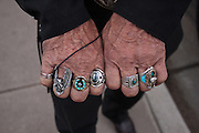close up rings on man fingers