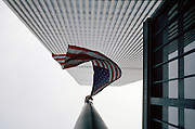flag from below against tall office buildings