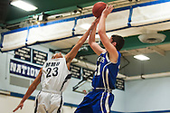 MMU's Nyahm Ali-Levin (23) blocks the shot by Colchester's Thomas Meadows (21) during the first round of the boys high school basketball playoffs between the Colchester Lakers and the Mount Mansfield Cougars at MMU High School on Tuesday night February 16, 2016 in Jericho. (BRIAN JENKINS/for the FREE PRESS)