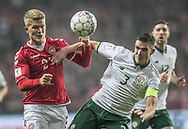 FOOTBALL: Andreas Cornelius (Denmark) and Ciaran Clark (Ireland) battle for the ball during the World Cup 2018 UEFA Play-off match, first leg, between Denmark and the Republic of Ireland at Parken Stadium on November 11, 2017 in Copenhagen, Denmark. Photo by: Claus Birch / ClausBirch.dk.