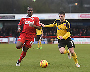 Robert Harris gets to the ball ahead of Mathias Pogba during the Sky Bet League 1 match between Crawley Town and Sheffield Utd at Broadfield Stadium, Crawley, England on 28 February 2015. Photo by David Charbit.