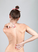 Naked Caucasian Woman with back pain