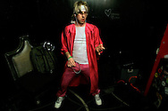 Andrew 'William Ocean' Litz prepares to perform during the regional finals of the US Air Guitar Champions in New York March 2, 2006. Litz won the contest giving him the chance to perform at the national championship where the  winner represents America in the world championship in Finland.