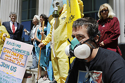 April 14, 2017 - San Diego, California, U.S. - People who want nuclear waste removed from the San Onofre Nuclear Generating Station gathered on the steps of San Diego Superior Court for a demonstration featuring a cappella singing, surfboards and speeches.  ROSS MCDOWELL  of Carlsbad surfs Lower Trestles, not far from San Onofre Nuclear Generating Station and came to the rally to protest wearing a gas mask. (Credit Image: © John Gastaldo via ZUMA Wire)