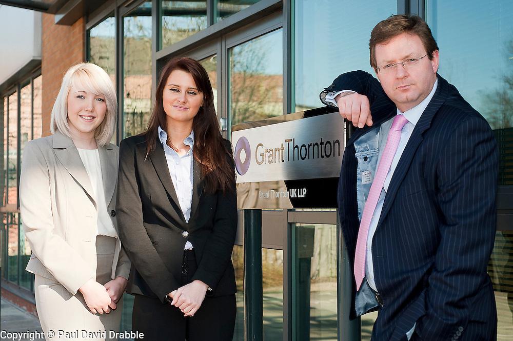 Grant Thorntons newest Recruits Phoebe Tresize (left) and Sarah Clark with Grant Thornton Partner Paul Houghton..http://www.pauldaviddrabble.co.uk.26 March 2012 .Image © Paul David Drabble