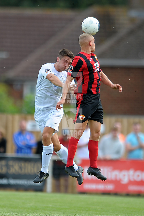 TELFORD COPYRIGHT MIKE SHERIDAN Adam Walker battles for a header during the National League North fixture between Kettering Town and AFC Telford United at Latimer Park on Saturday, August 3, 2019<br /> <br /> Picture credit: Mike Sheridan<br /> <br /> MS201920-005
