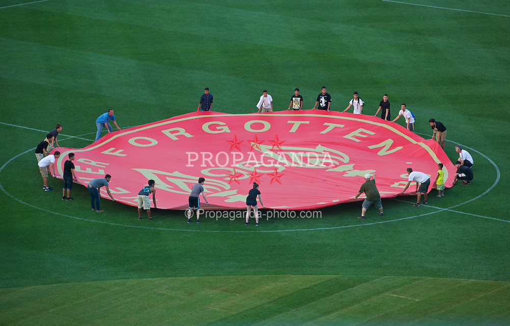 BOSTON, USA - Tuesday, July 22, 2014: A banner on the centre circle of the pitch at Fenway Park in Boston remembering the 96 victims of the Hillsborough Stadium Disaster on two one of the club's USA Tour. (Pic by David Rawcliffe/Propaganda)