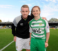 Yeovil Town's Paddy Madden has his photo taken with a young Yeovil Town mascot - Photo mandatory by-line: Dougie Allward/JMP - Tel: Mobile: 07966 386802 10/11/2013 - SPORT - FOOTBALL - Huish Park - Yeovil - Yeovil Town v Wigan Athletic - Sky Bet Championship