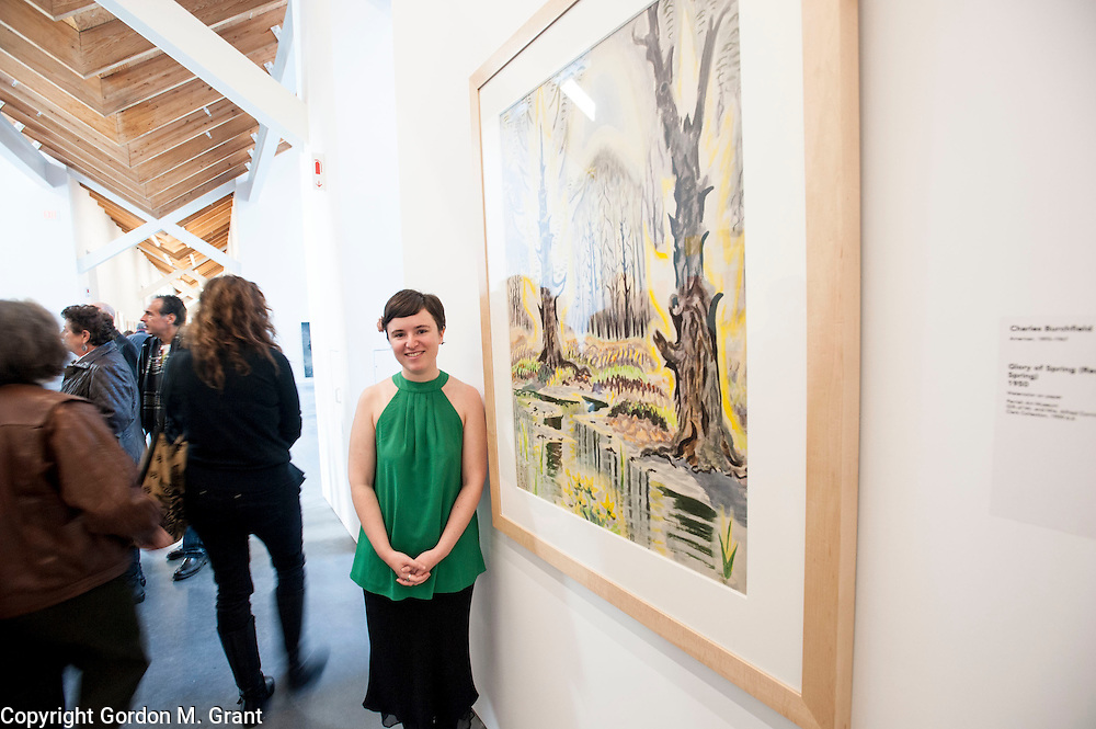 The composer Nell Shaw Cohen, who grew up in Sag Harbor, stands next to a Charles Burchfield painting, that inspired some of her music that she played during the public grand opening of the new location of the Parrish Art Museum in Water Mill Saturday afternoon. (November 10, 2012)