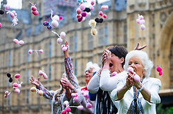 'Knitting nans' form a knit-in outside Parliament for equal parenting group Fathers4Justice, to lobby for separated fathers to have greater access to their children. The nans are taking a stand to say 'balls to a fatherless Father's Day'. London, June 04 2018.