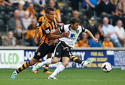 Hull City's Jake Livermore is booked for this challenge on Norwich City's Wes Hoolahan  - Photo mandatory by-line: Matt Bunn/JMP - Tel: Mobile: 07966 386802 24/08/2013 - SPORT - FOOTBALL - KC Stadium - Hull -  Hull City V Norwich City - Barclays Premier League