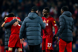 Divock Origi of Liverpool celebrates with Liverpool manager Jurgen Klopp after beating Arsenal after a penalty shootout - Mandatory by-line: Robbie Stephenson/JMP - 30/10/2019 - FOOTBALL - Anfield - Liverpool, England - Liverpool v Arsenal - Carabao Cup