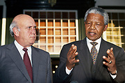 Former President FW De Klerk and Nelson Mandela address the media at Tuynhuis in Cape Town, South Africa, May 6, 1994. <br /> <br /> Photograph &copy; nic bothma
